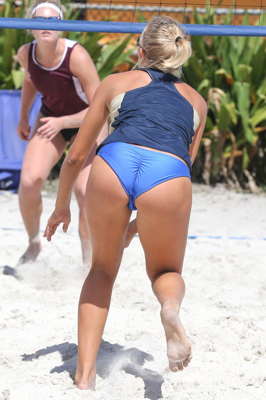 pretty beach volleyball team in blue panties