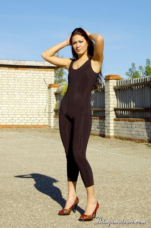 leggy brunette lady in black unitards & high heels