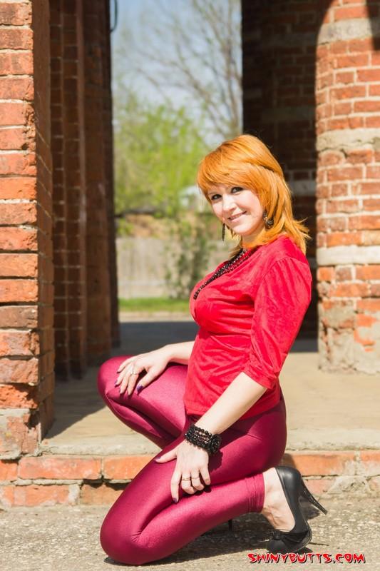 ginger lady Nastya in burgundy leggings & high heels