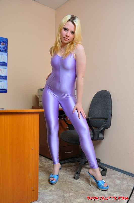 blonde secretary girl Julia in kinky purple costume