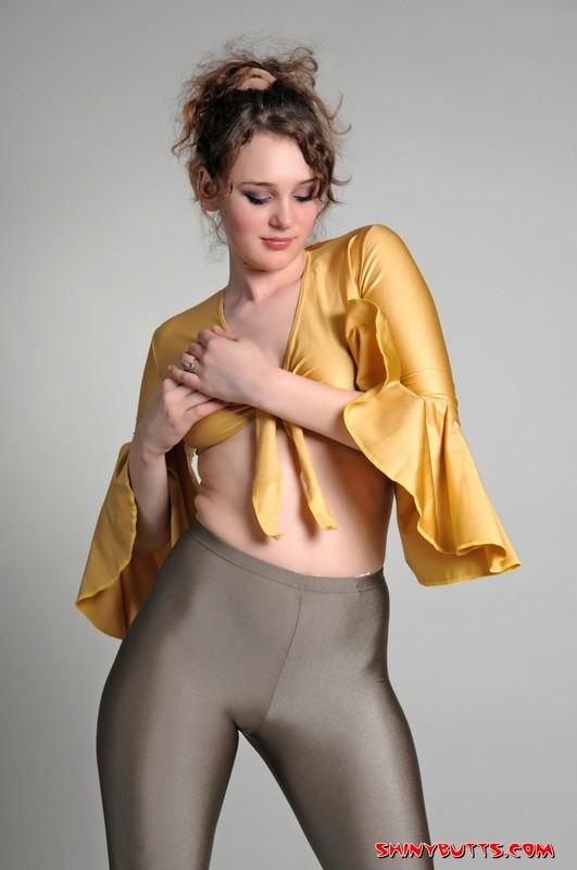 delicious female Lena in shiny leggings