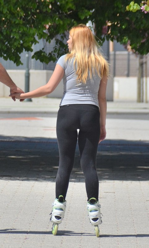 blonde roller blade girl in sexy black yogapants