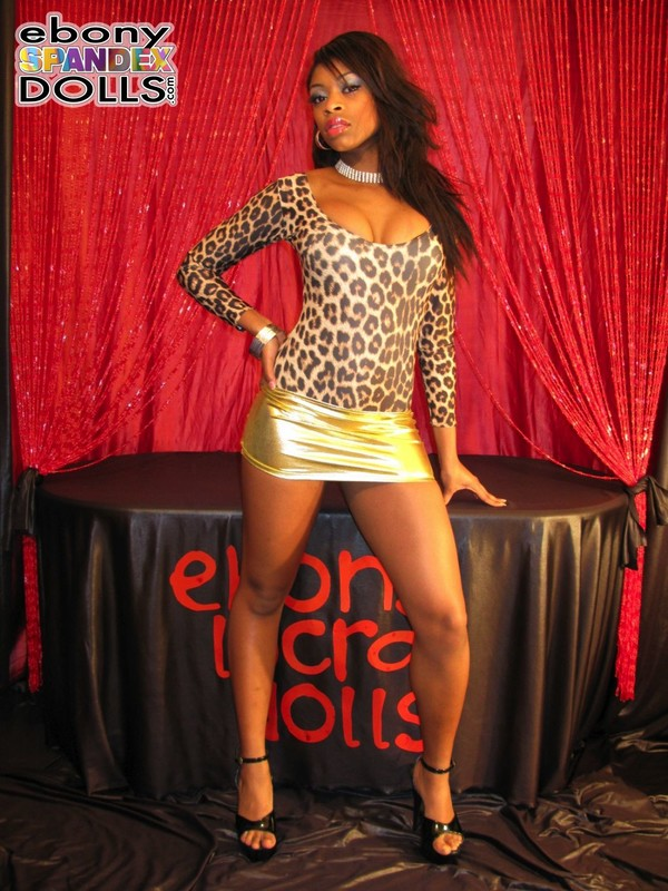 african lady Peaches in leopard style leotards & miniskirt
