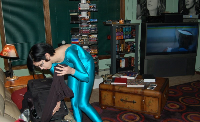 petite model Gina in turquoise catsuit
