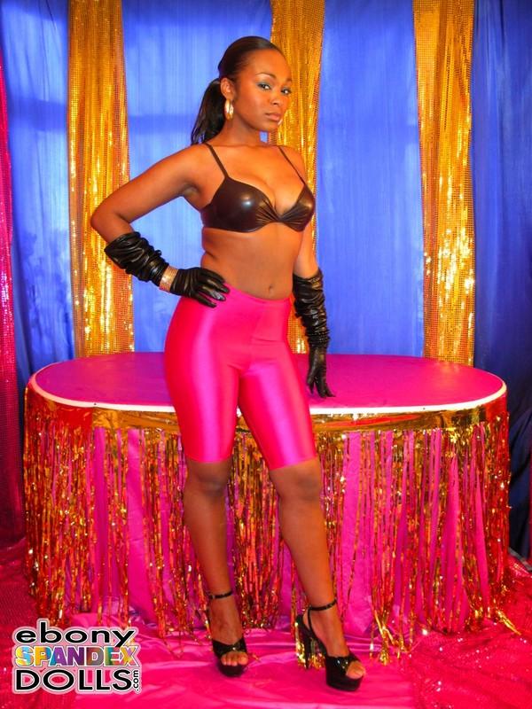 african babe Yasmin in sexy purple lycra shorts