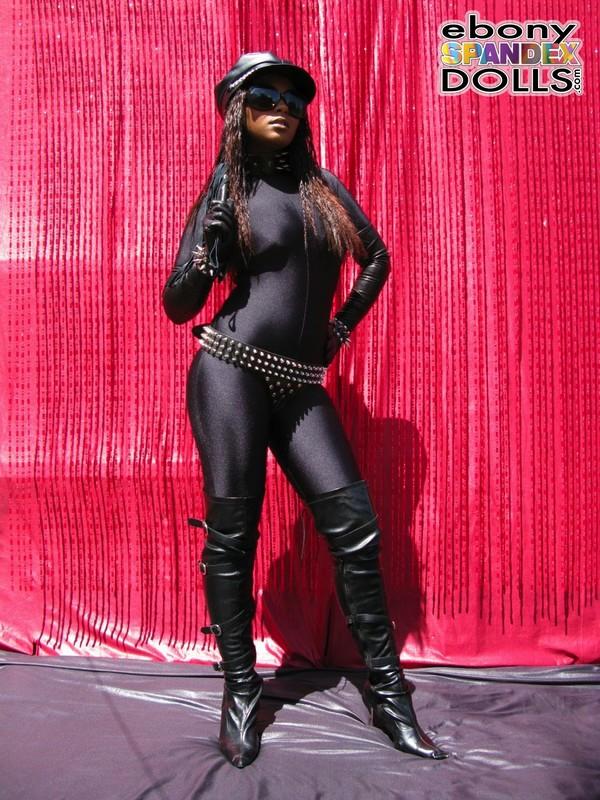 horny dominatrix Yasmin in catsuit & boots