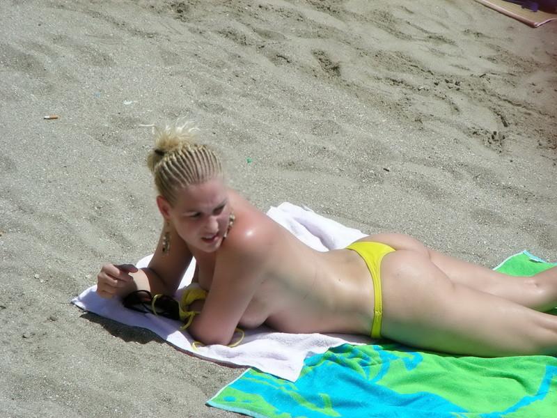 topless blonde chick in yellow bikini