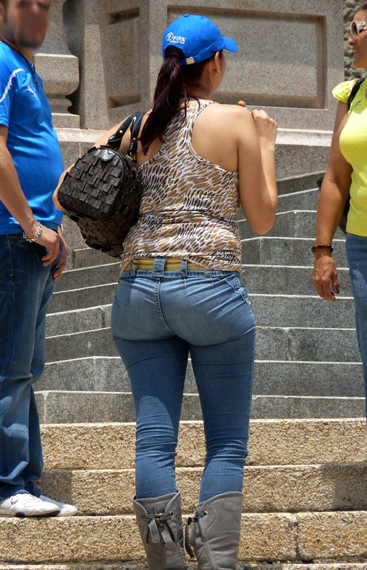 curvy redhead lady in jeans & boots