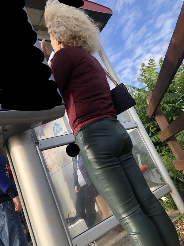 handsome milf booty in green leather trousers