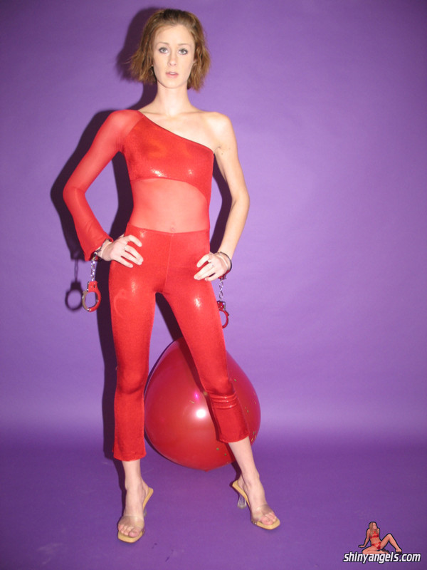 kinky shiny angel in red spandex & handcuffs