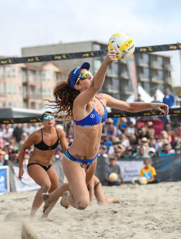 handsome sand volleyball girls in bikini