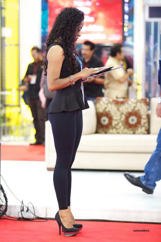 hispanic promo babe in tight black lycra pants & high heels