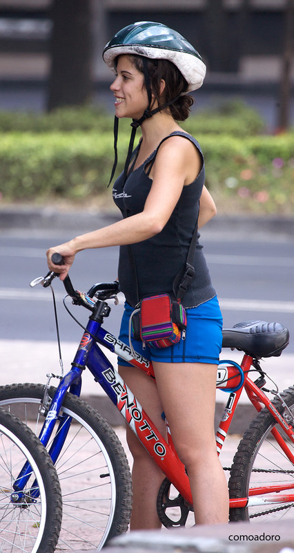 handsome cyclist babe in blue shorts