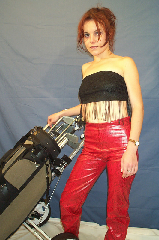 sexy golfer babe in shiny red pants