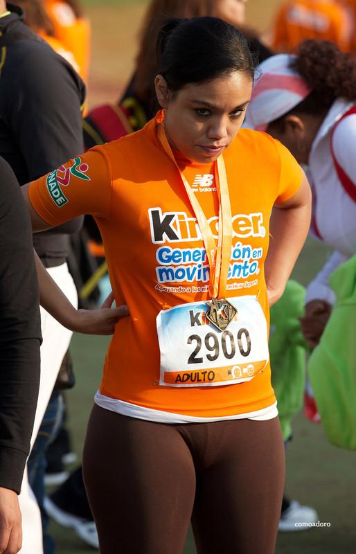 hispanic marathon lady in brown leggings