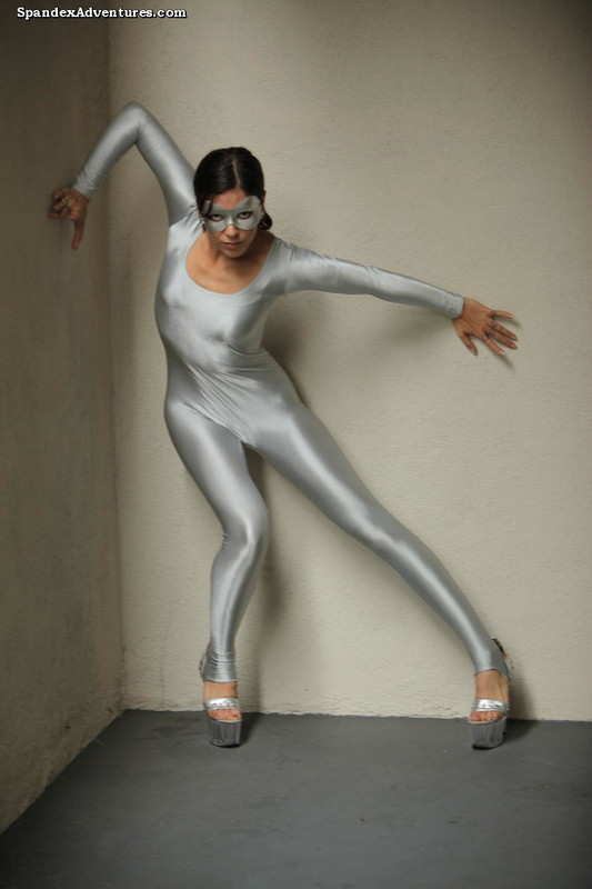 mysteries gymnast lady in silver catsuit