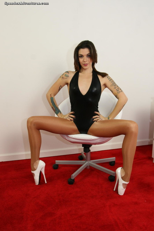 handsome tattooed babe in pantyhose & shiny black leotards