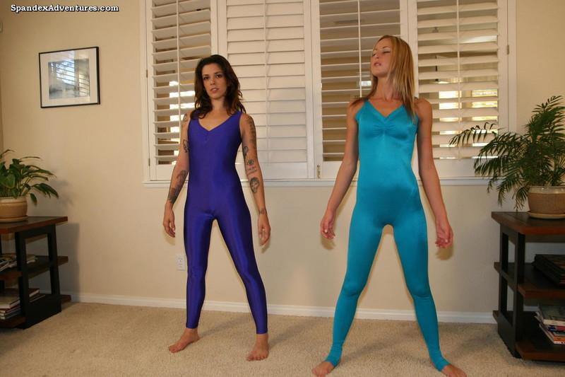 2 lesbian yoga girls in unitards