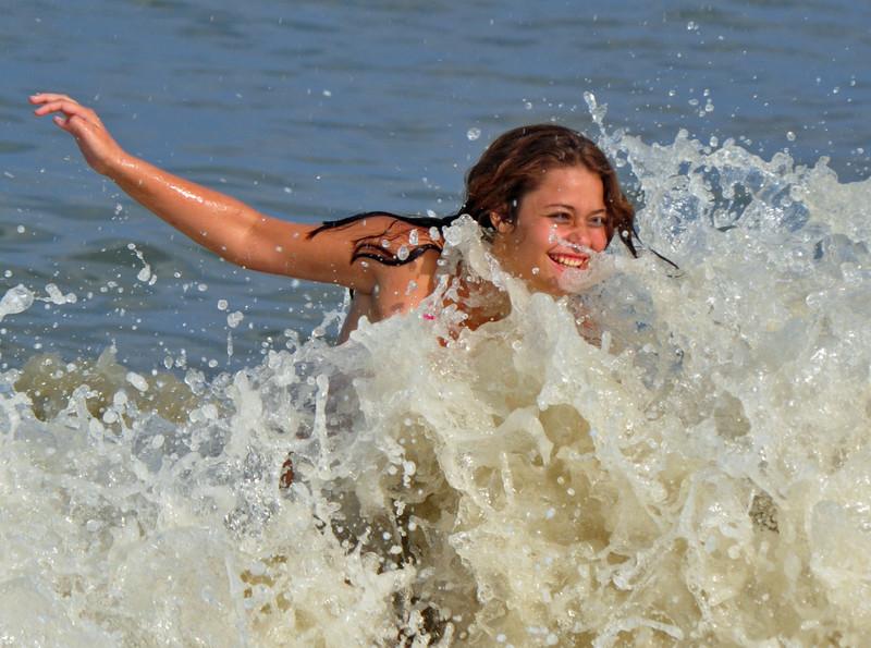 cheerful college teen in wet bikini