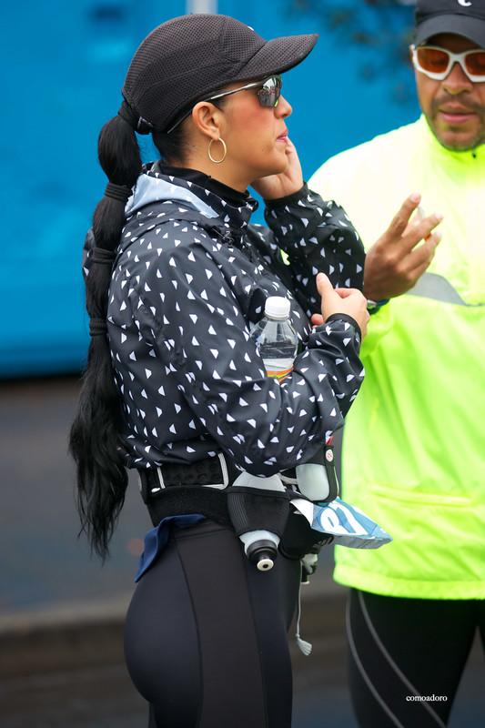 marathon lady in black shiny leggings