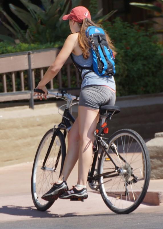 cyclist lady in candid grey lycra shorts