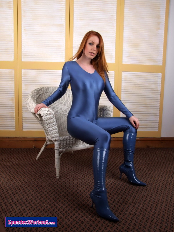 redhead hottie in a shiny blue catsuit