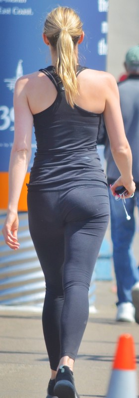 blonde jogger babe in candid black leggings