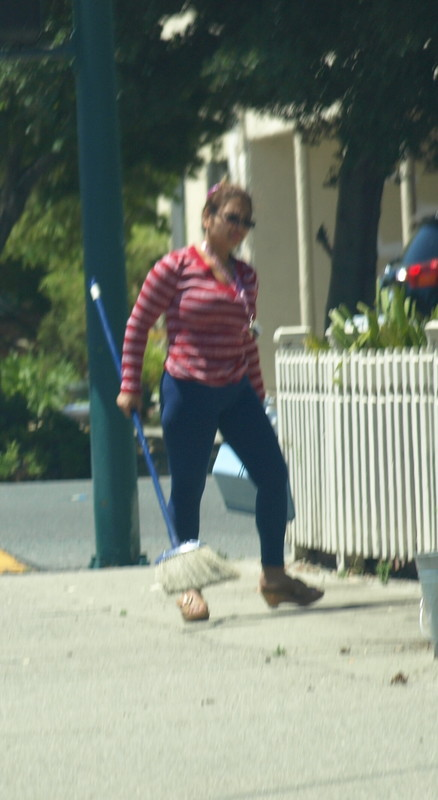 mature asian cleaner lady in tight blue leggings