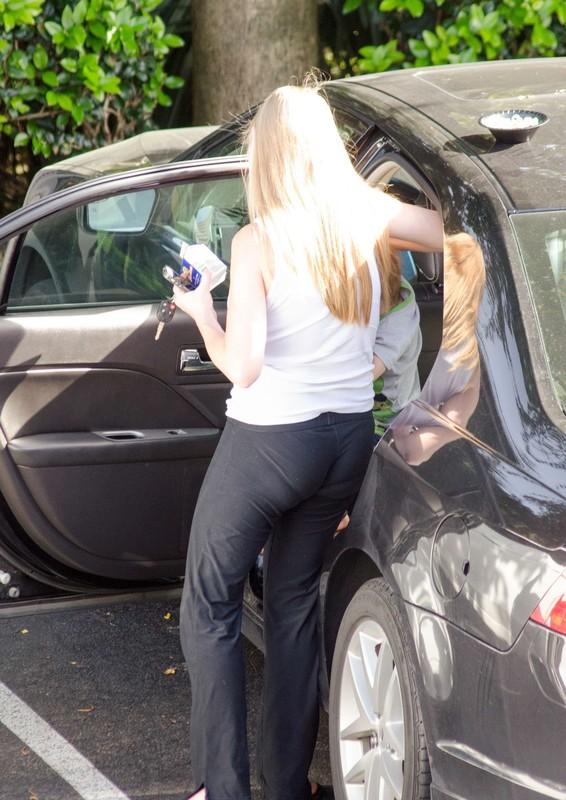 blonde milf in lovely black yoga pants