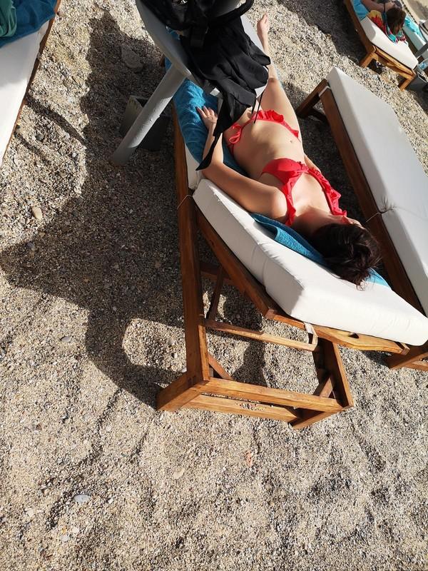 sunbather milf in sexy red bikini