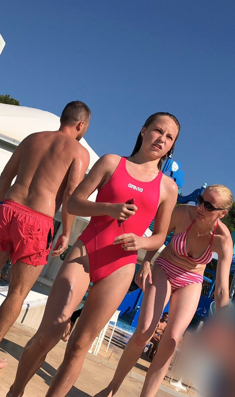 handsome teen in a red arena swimsuit