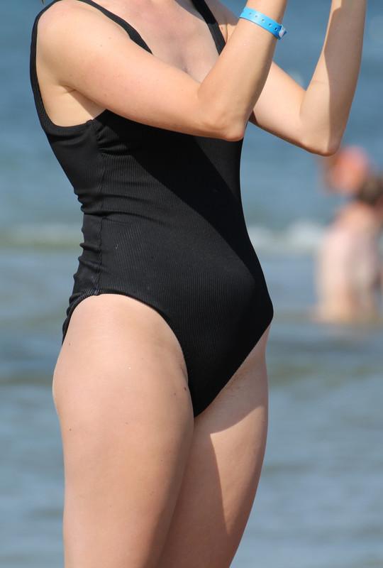 nerdy chick in black 1 piece swimsuit