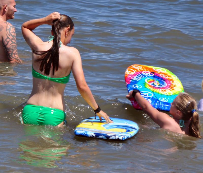 pretty teen in wet green bikini