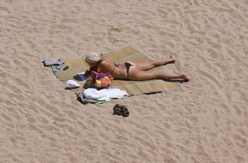 reading girl at the beach in bikini
