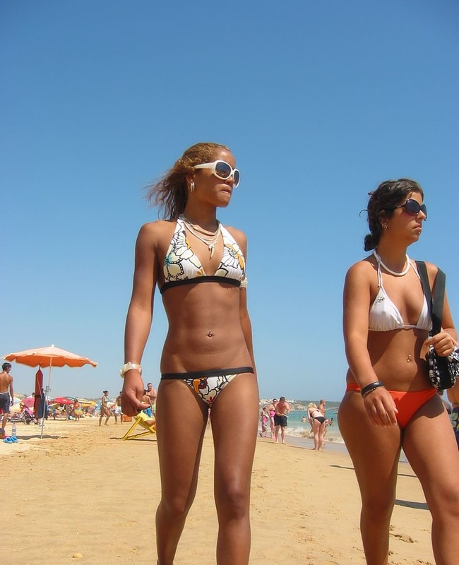 slim and pierced beach babe in bikini