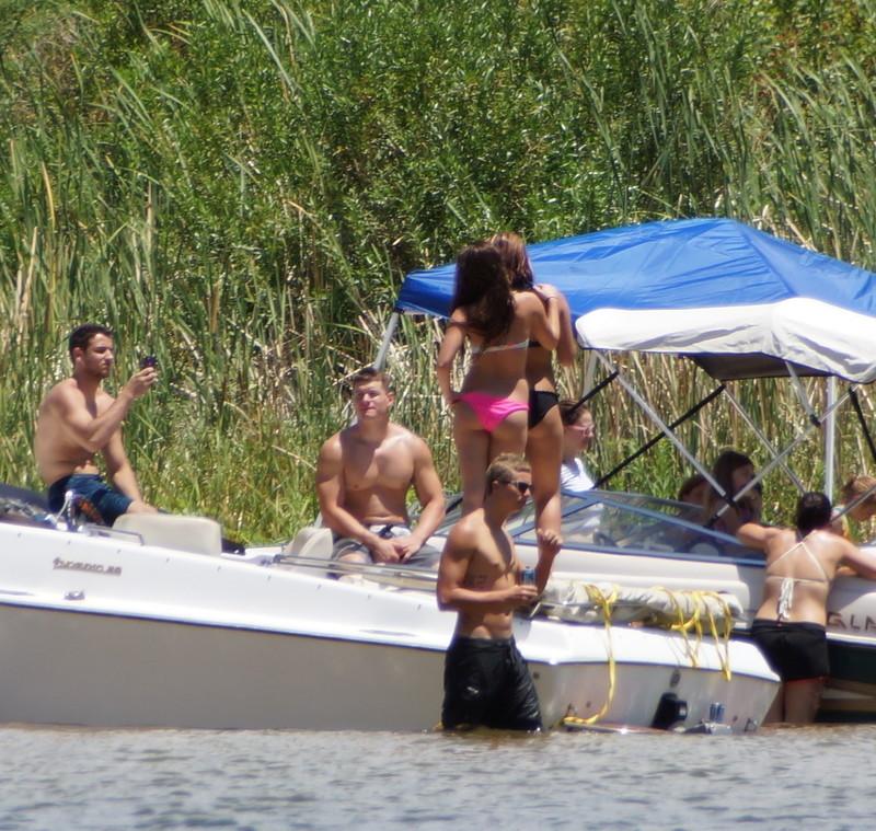 2 hot bikini babes frolicking in the lake