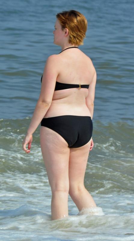 curvy short hair lady in black bikini