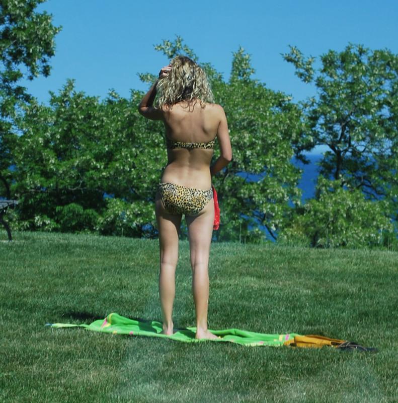 city park lady in leopard print bikini