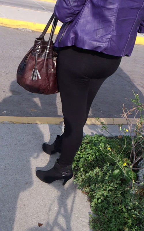 milf butt in black leggings & high heels
