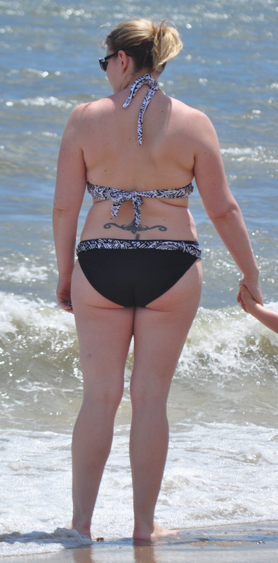 handsome beach milf in bikini