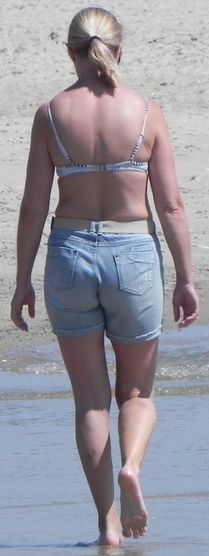blonde milf in jeans shorts at the beach