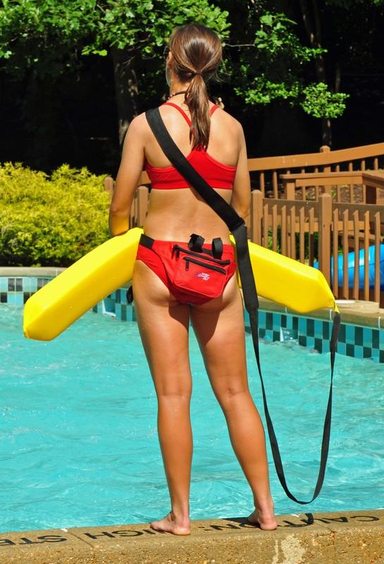 skinny lifeguard chick in red bikini
