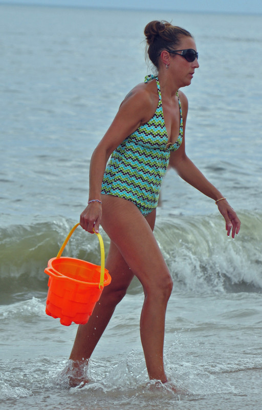 swimsuit milf bringing water for sand castle