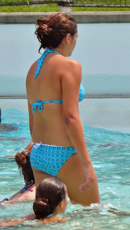 swimming pool female in pretty blue bikini