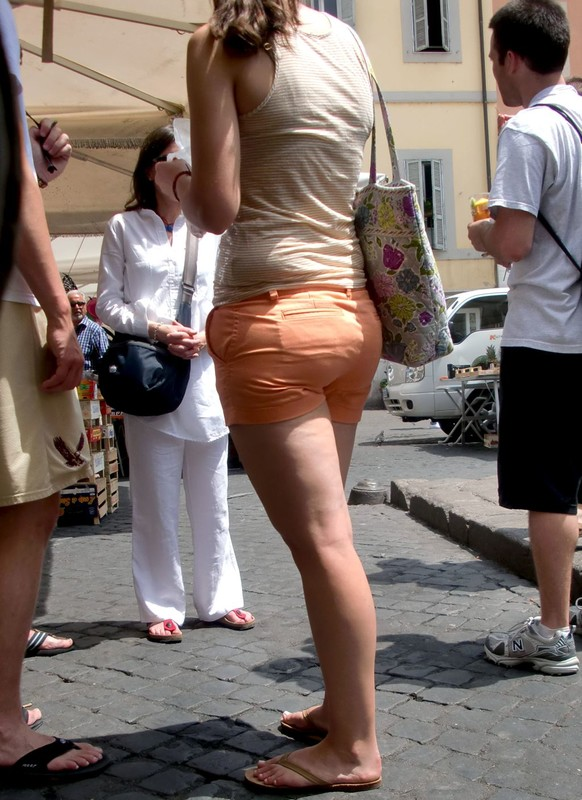 great butt girl in orange shorts