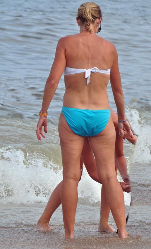 handsome mature lady in strapless bikini