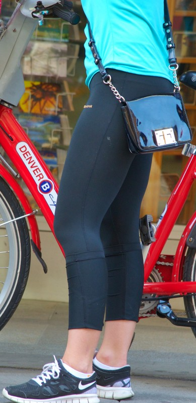 sexy blonde cyclist lady in reebok leggings