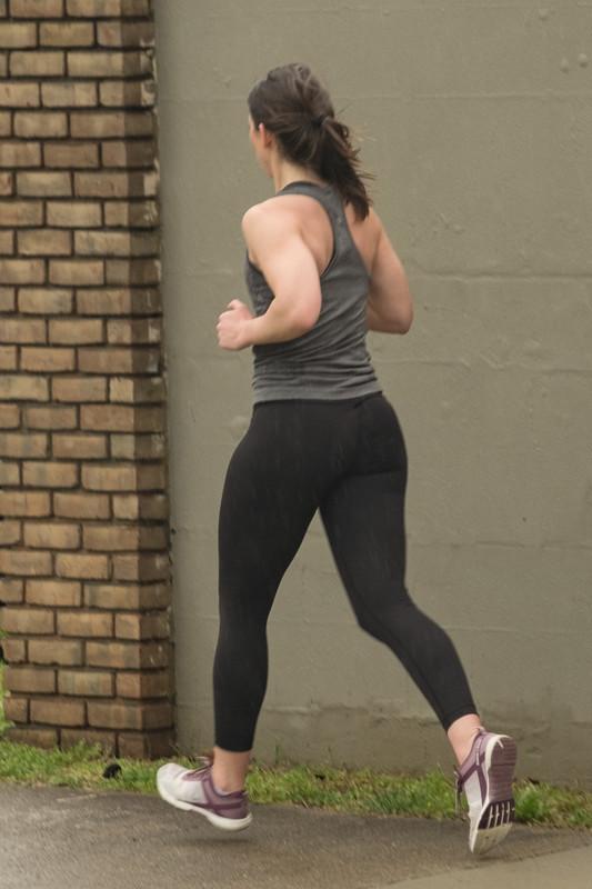 beautiful jogger babe in wet leggings