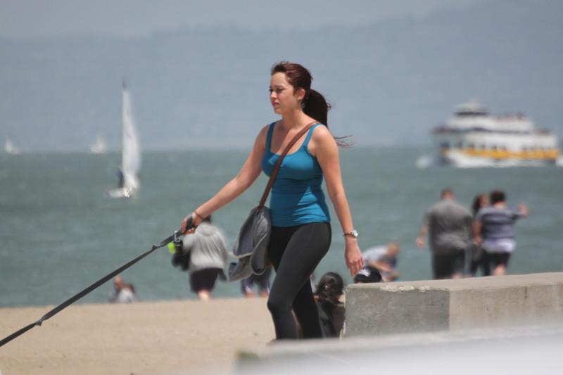 pretty lady dogwalker in yogapants