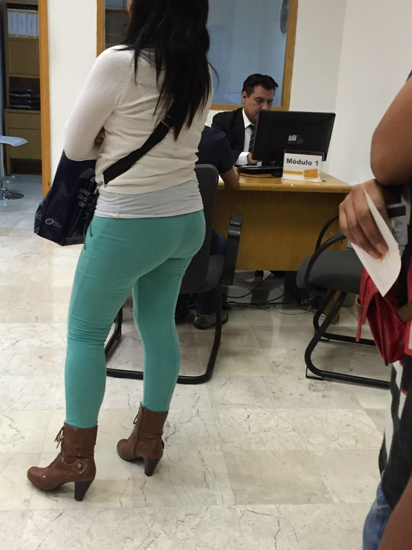 hot milf booty in tight green pants & boots